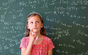 A puzzled girl in front of a board covered in equations.