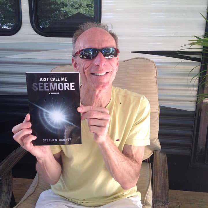 "man holding a book entitled ""Just Call Me Seemore"""